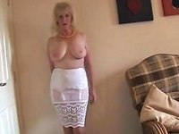 Mature Busty Lady In Stockings And Sheer Slip